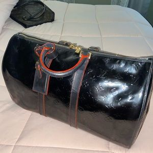 Louis Vuitton Vernis black Mercer duffle